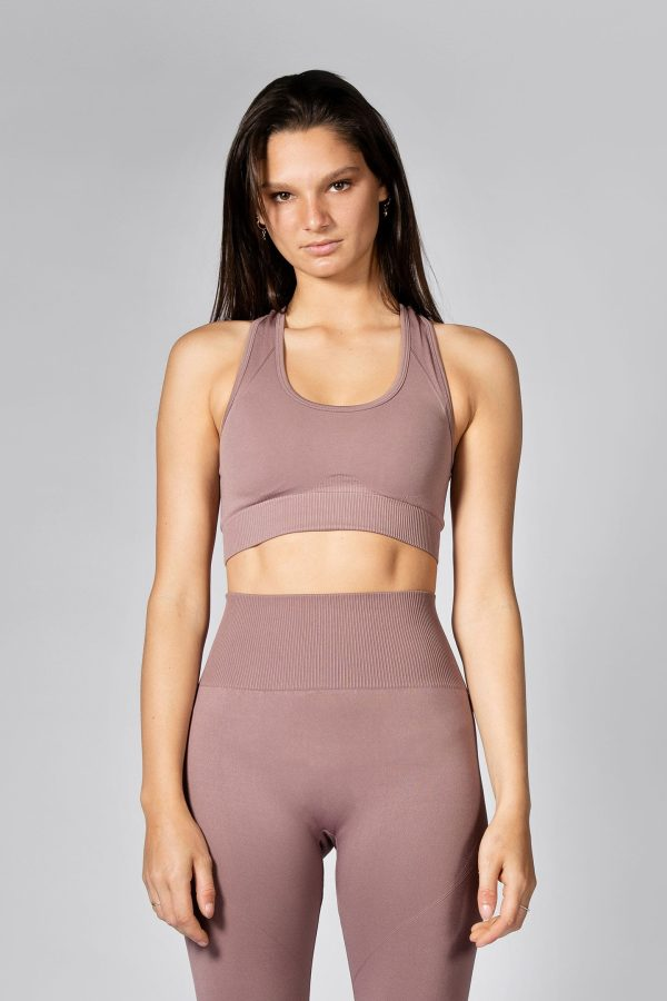good looking model posing in seamless sports bra in champagne colour
