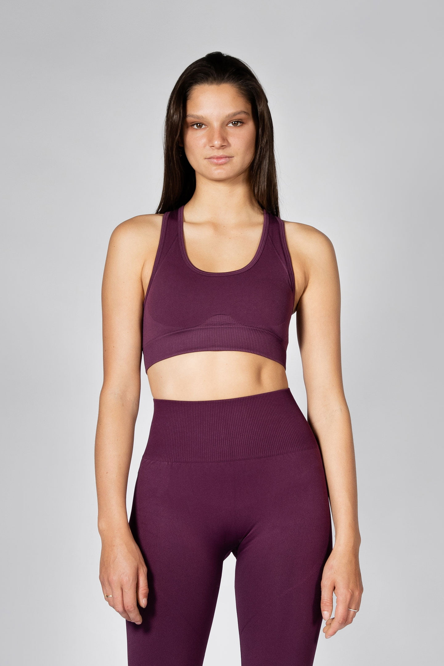 fit model wearing seamless sports bra in grape colour
