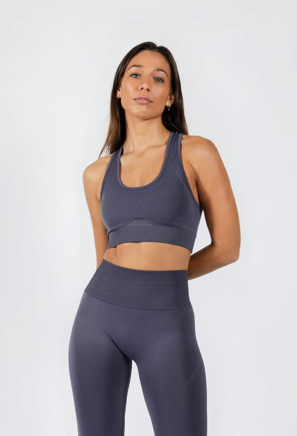 model posing in women's yoga pants and sports bra in grey colour