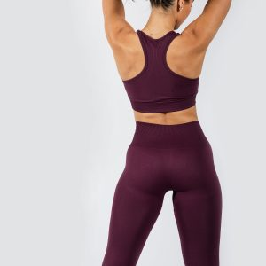 Model posing in Muki yoga pants and sports brea in grape colour