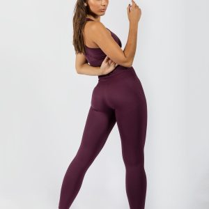 model posing in women's sports bra and yoga pants in grape colour