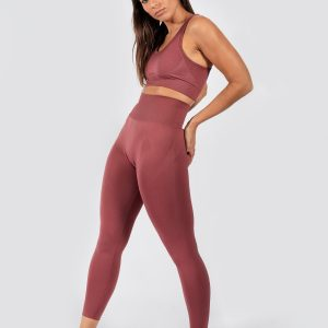 model posing in seamless sports bra and yoga pants in rouge pink colour