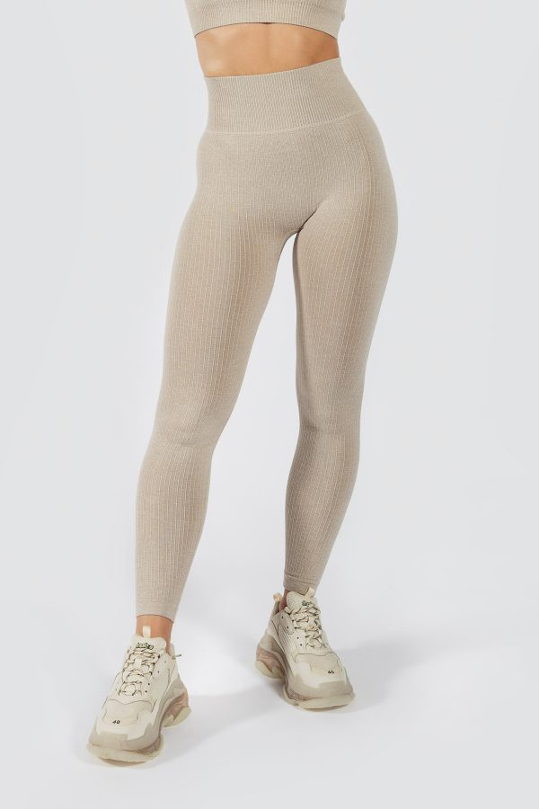 fit model wearing seamless ribbed legging in beige colour