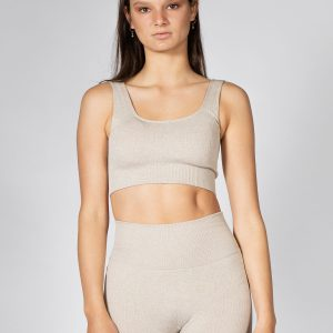 professional model wearing seamless ribbed sports bra in beige colour
