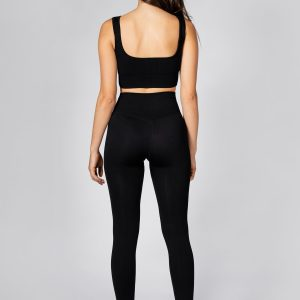 fit model posing in black seamless ribbed leggings