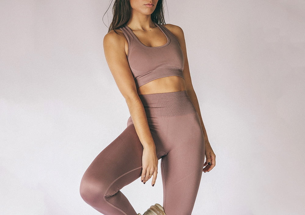 model wearing seamless sports bra and seamless legging in skin colour