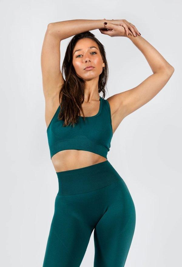 woman wearing seamless sports bra in emerald colour