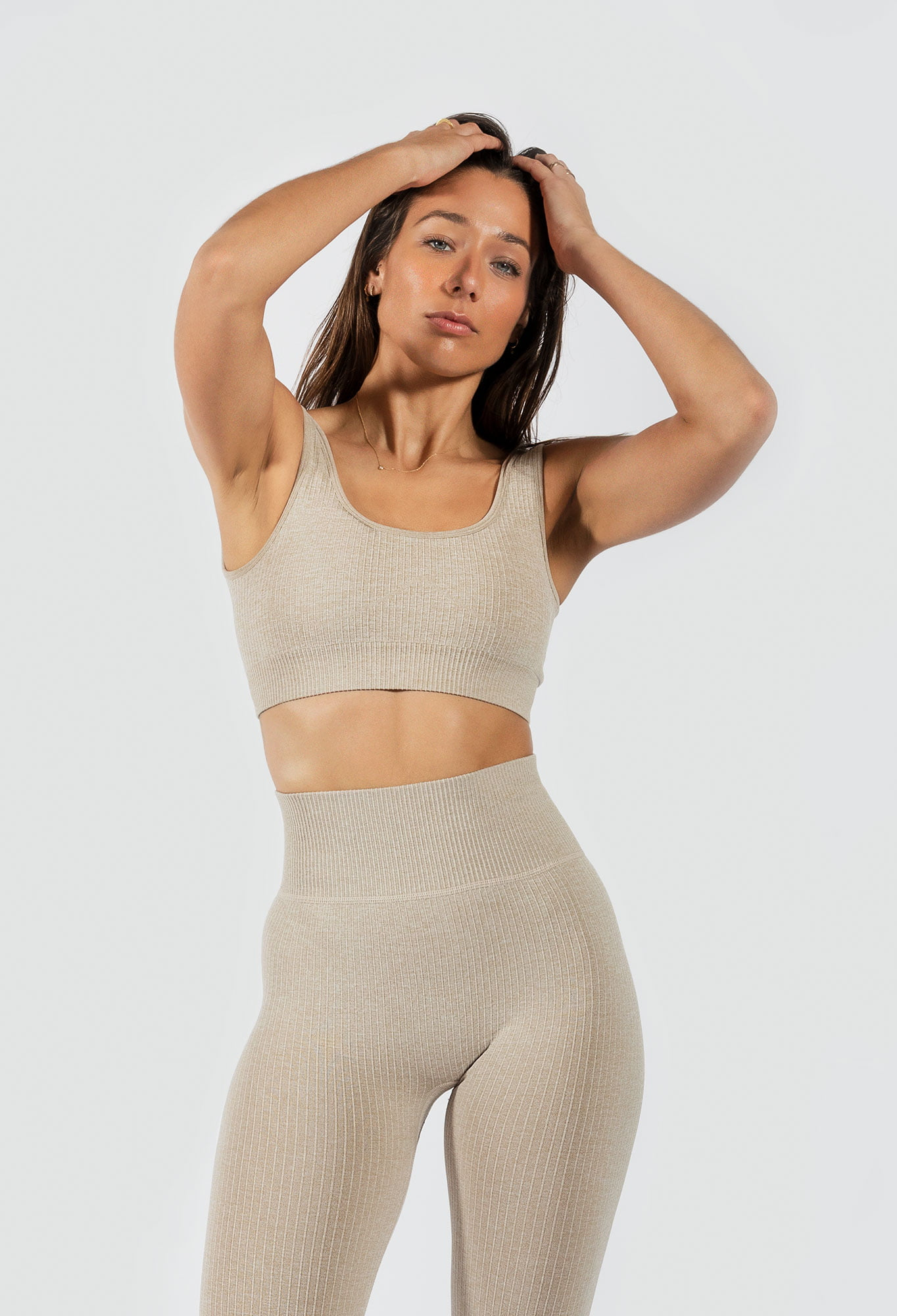 model wearing Muki ribbed seamless legging and sports bra in beige colour