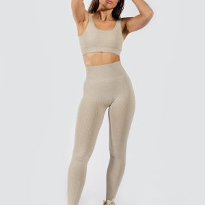model wearing Muki seamless legging and sports bra in beige colour
