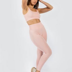model posing in Muki sports bra and seamless yoga pants in pink colour