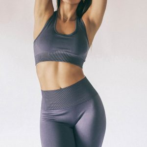 woman wearing Muki sports bra and seamless leggings in grey colour