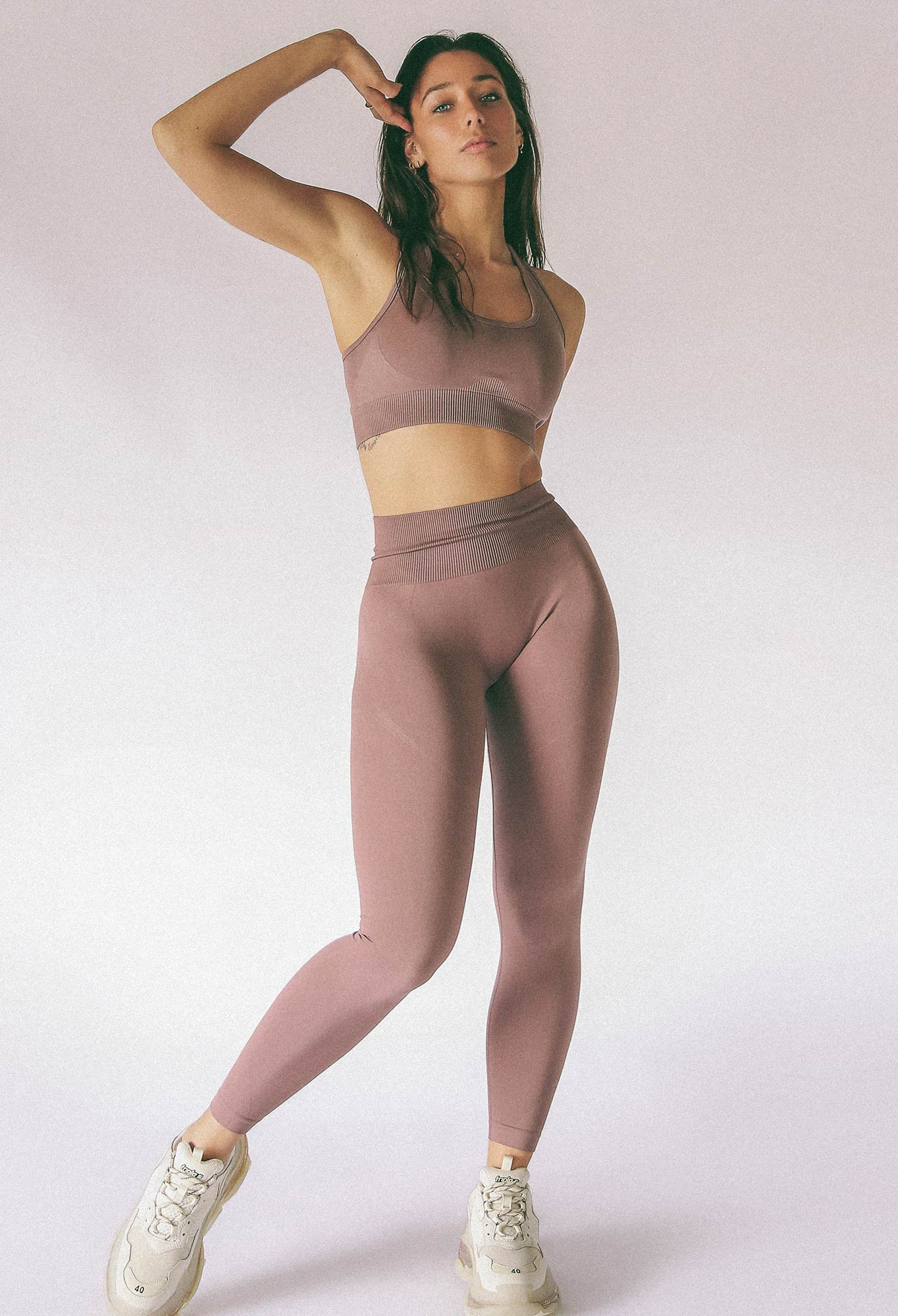 model wearing women's sports bra and yoga pants in skin colour