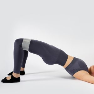 fit girl exercising with fabric resistance band