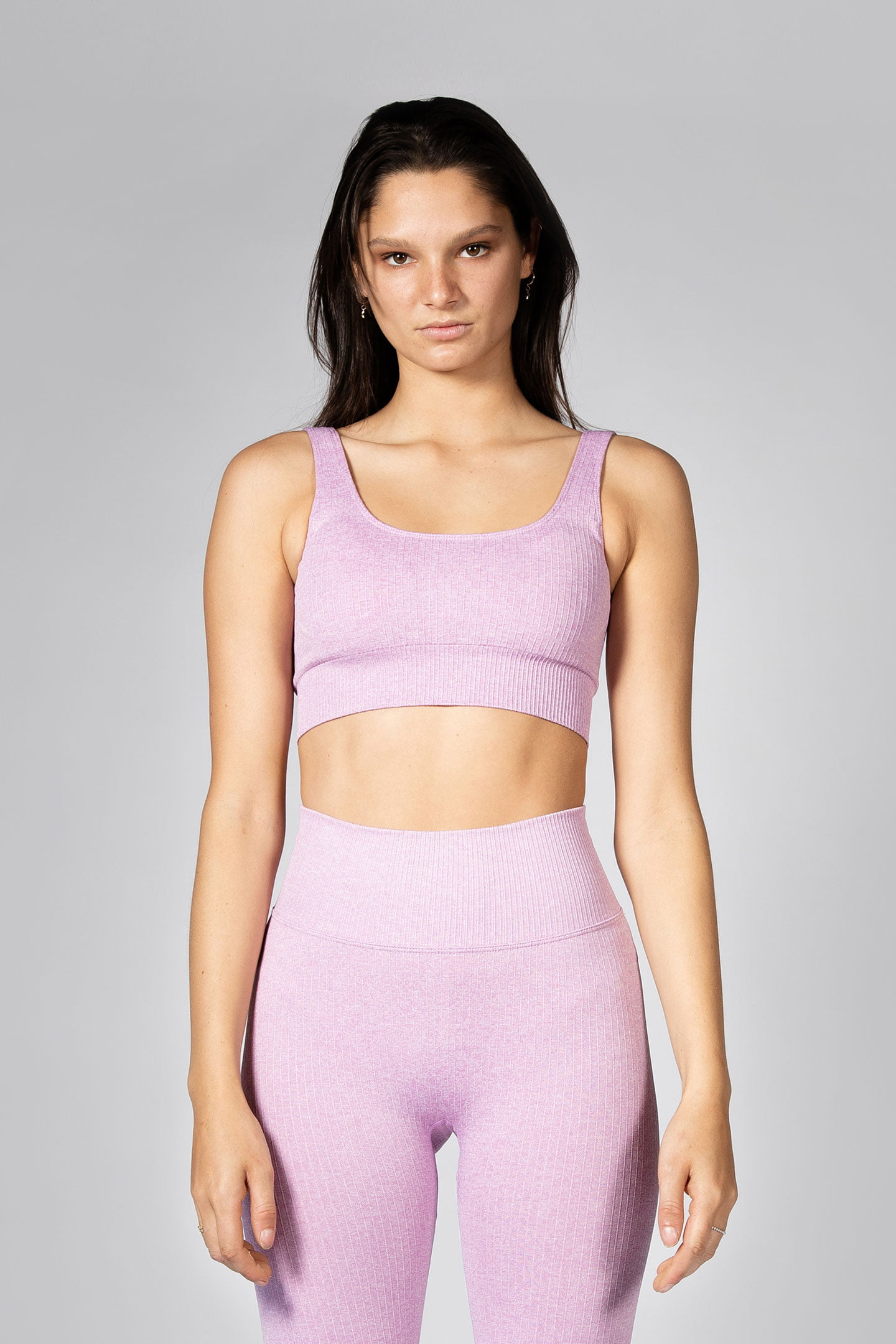 professional model posing in seamless ribbed sports bra in lilac colour