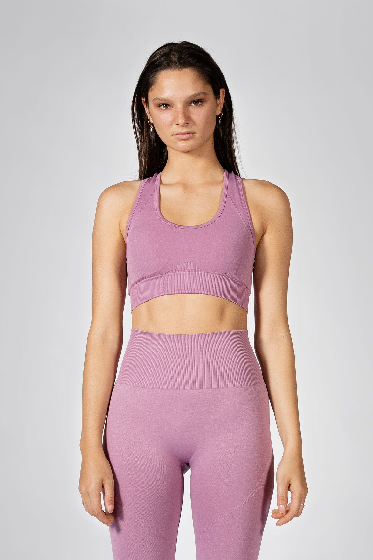 fit model posing in seamless sports bra in lilac colour