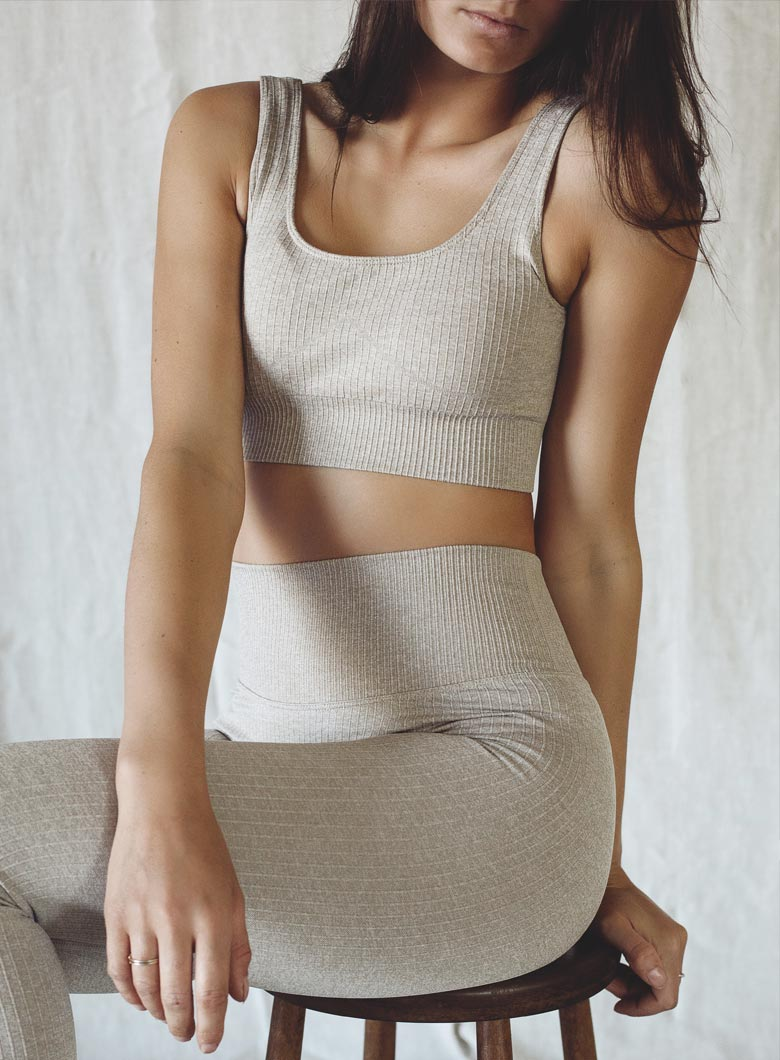 pretty girl wearing seamless ribbed yoga set in beige colour