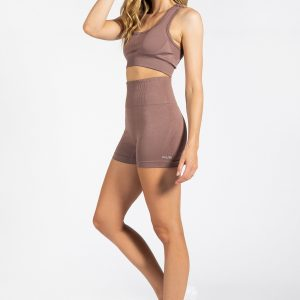 good looking model wearing high-waisted gym short in nude colour