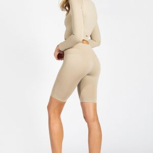 model projecting confidence in seamless long sleeve crop top in cream colour