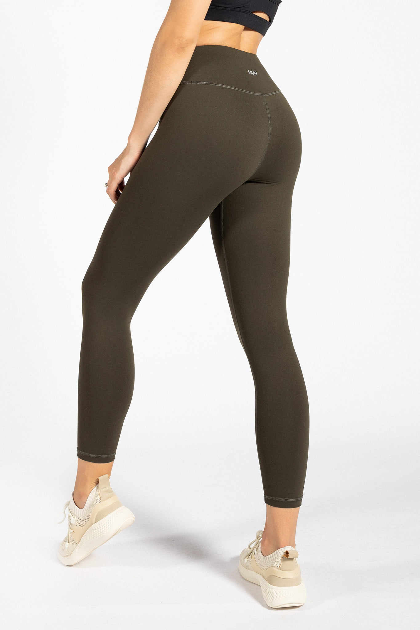 fit model wearing high-waisted yoga pant in dark olive colour