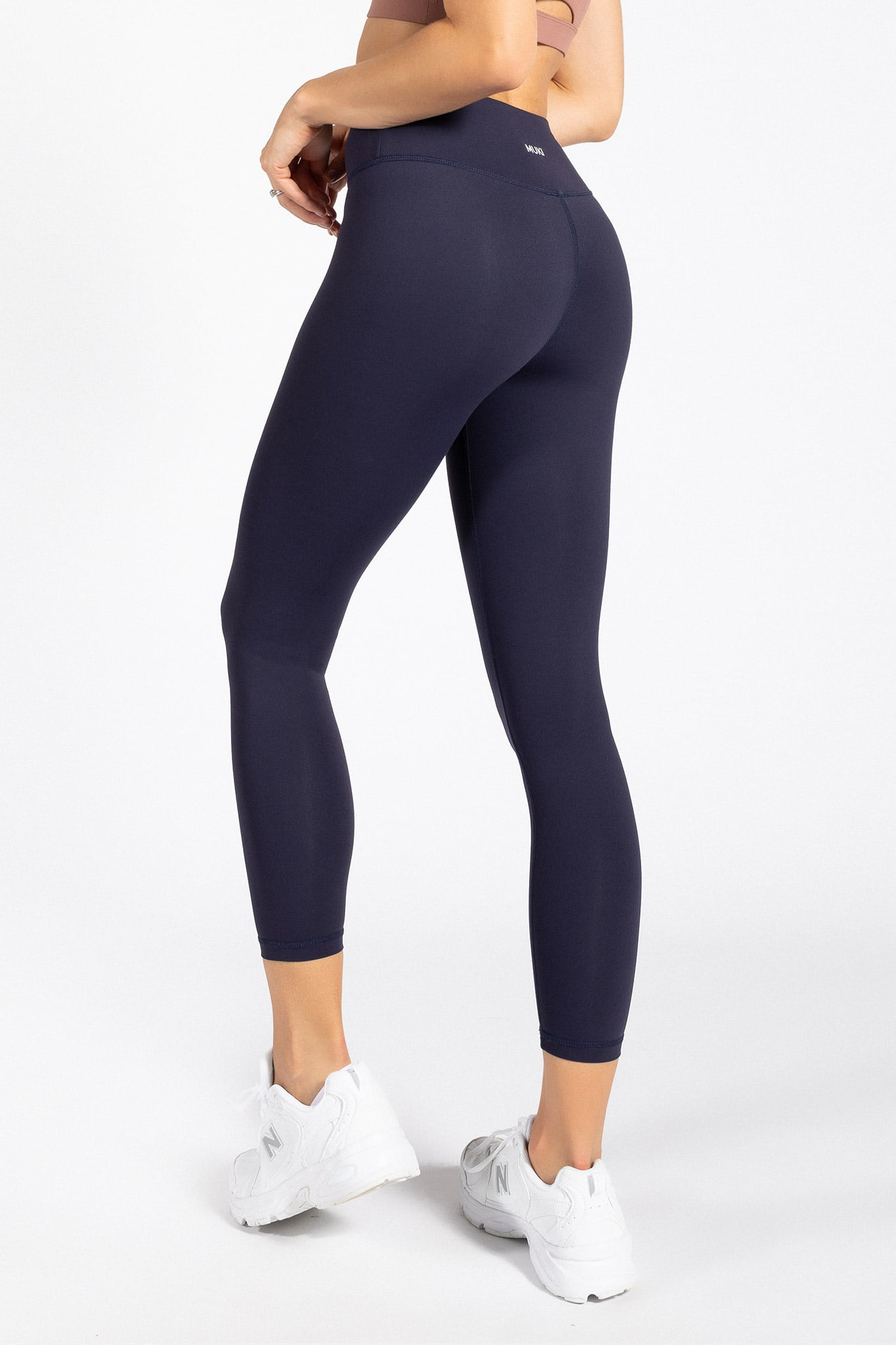 model wearing high-waist 7/8 yoga pant in navy colour
