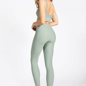 fit model wearing high-waisted ribbed yoga pant in soft green colour