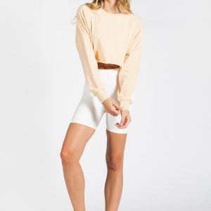 fit girl wearing long sleeve crop top in sand colour
