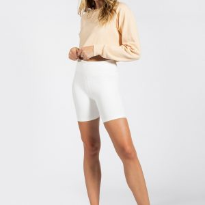good looking woman wearing long sleeve crop tom in ivory colour
