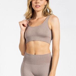 fit girl posing in seamless ribbed sports bra in light brown colour