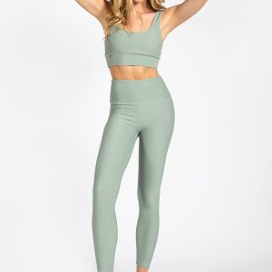 fit model posing in high-waisted ribbed yoga pant in light green colour