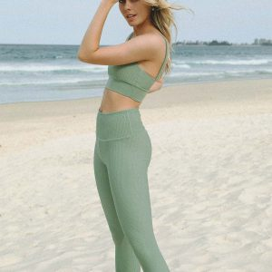 good looking girl wearing seamless ribbed yoga pant in light green colour