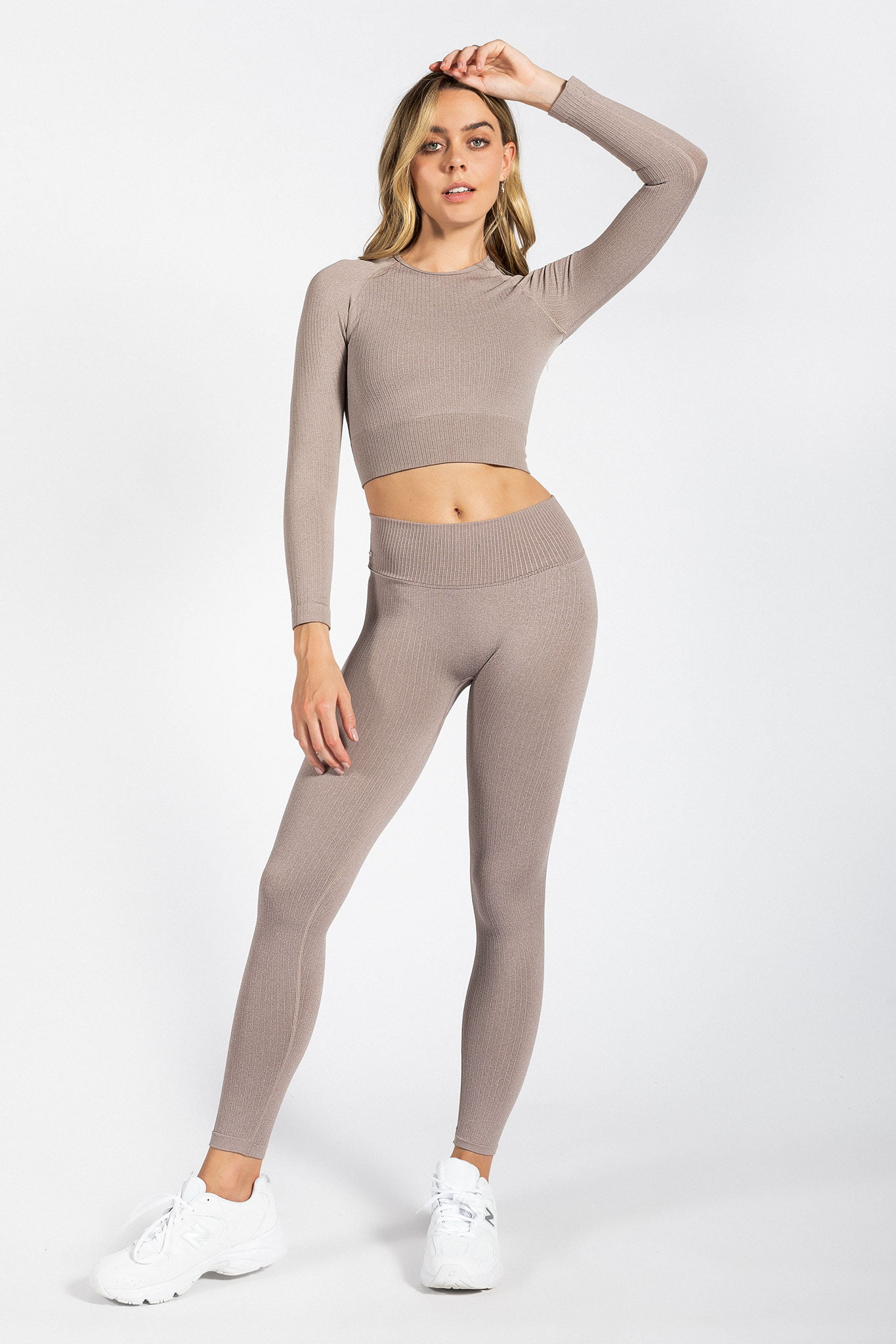 pretty girl wearing seamless high-waist yoga pant in light brown colour