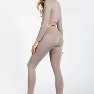 fit girl posing in high-waist ribbed yoga pant in light brown colour