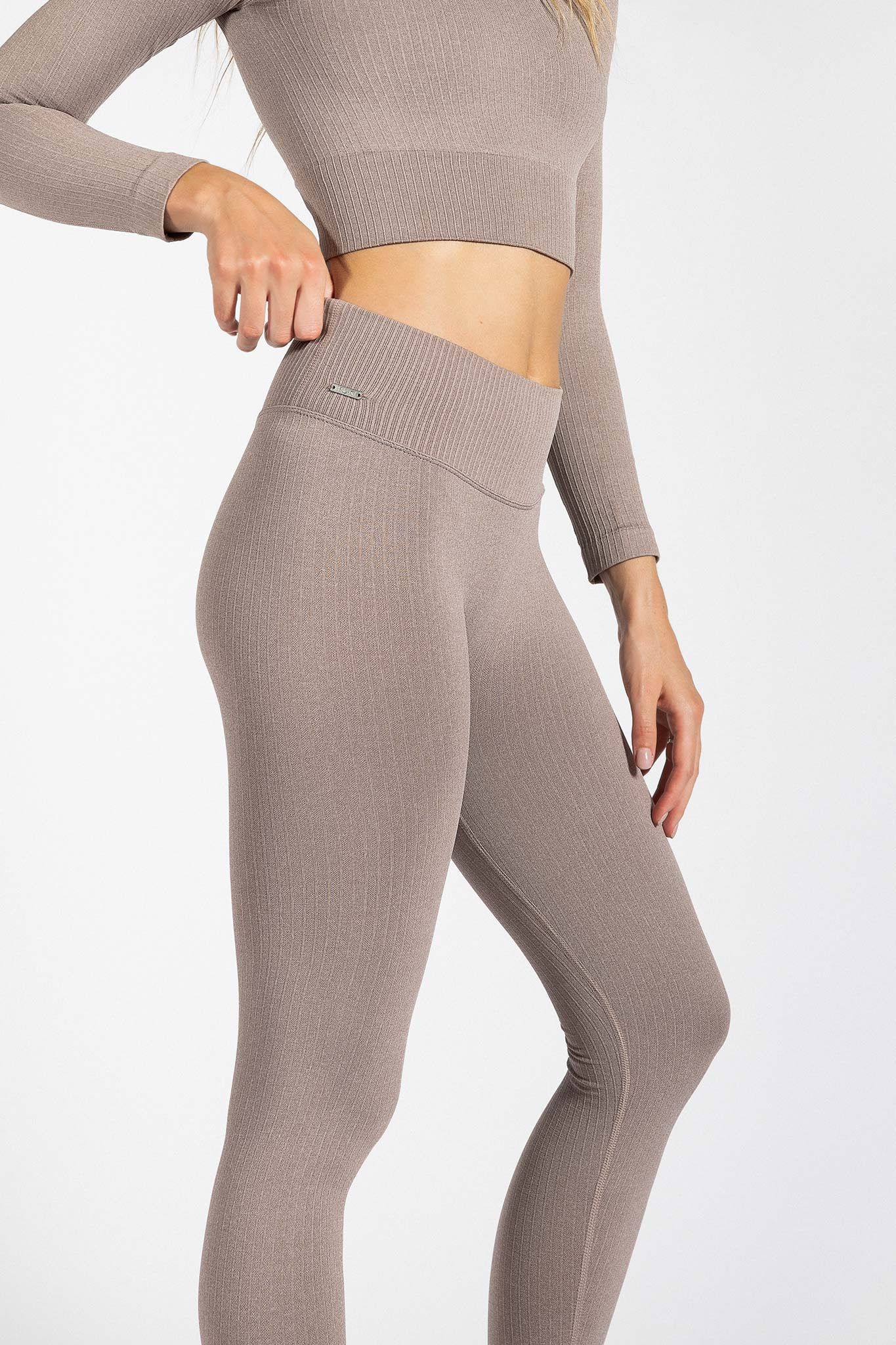 fit girl posing in seamless ribbed yoga pant in light brown colour