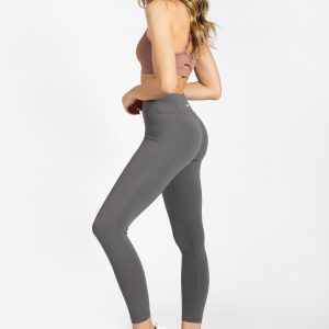 young woman wearing high-waist legging in grey colour