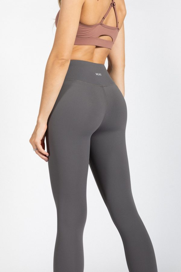 fit model wearing high-waisted yoga pants in grey colour